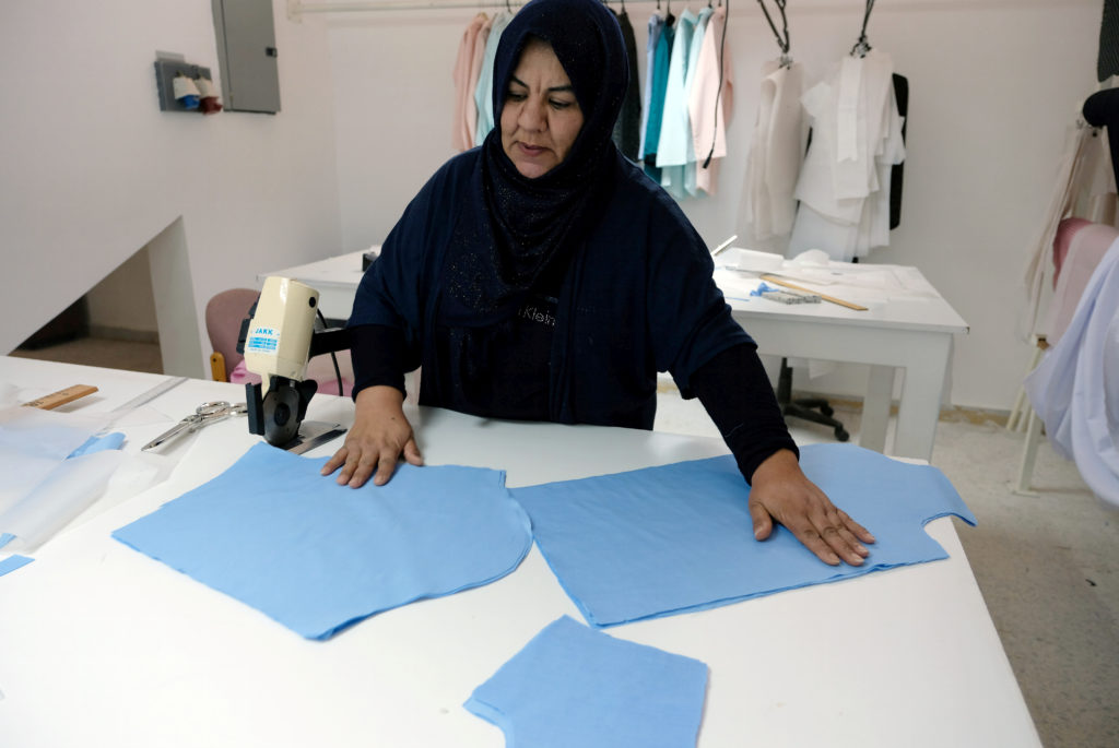 A woman works in a sewing workshop supervised by a charity to help widows, divorcees and needy in Benghazi, Libya on Sept. 22. Photo by Esam Omran Al-Fetori/Reuters