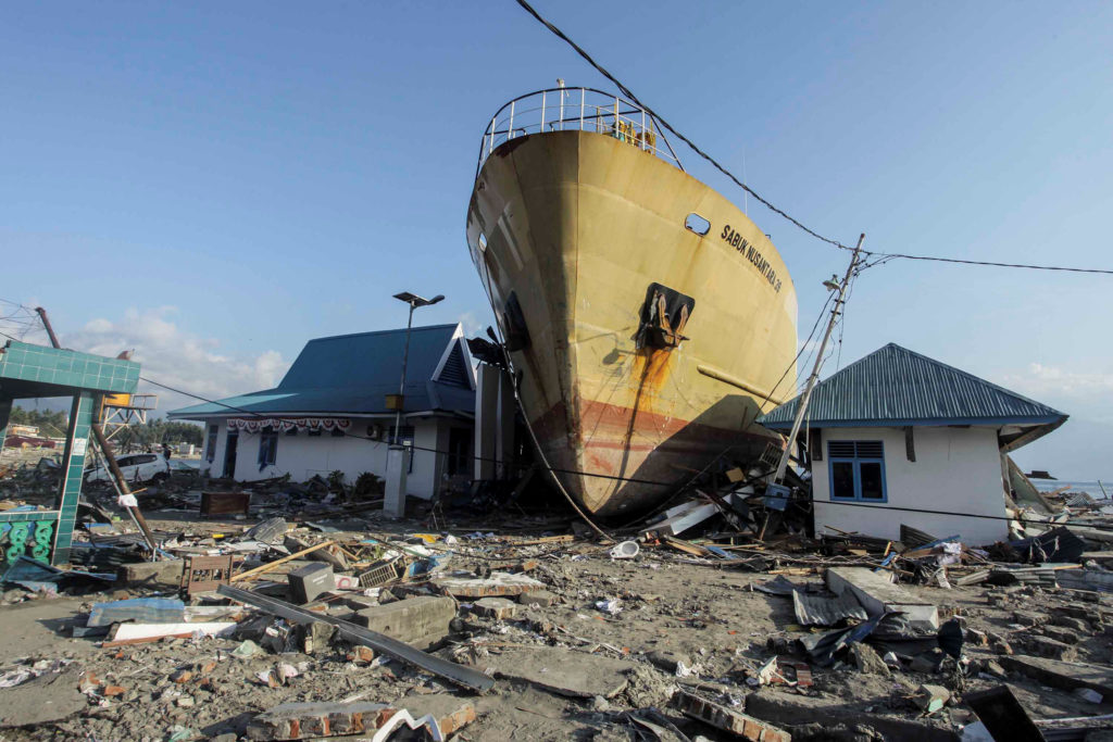 The earthquake and tsunami crushed thousands of homes in Indonesia's Sulawesi region. Photo by Antara Foto/Muhammad Adimaja/ via Reuters