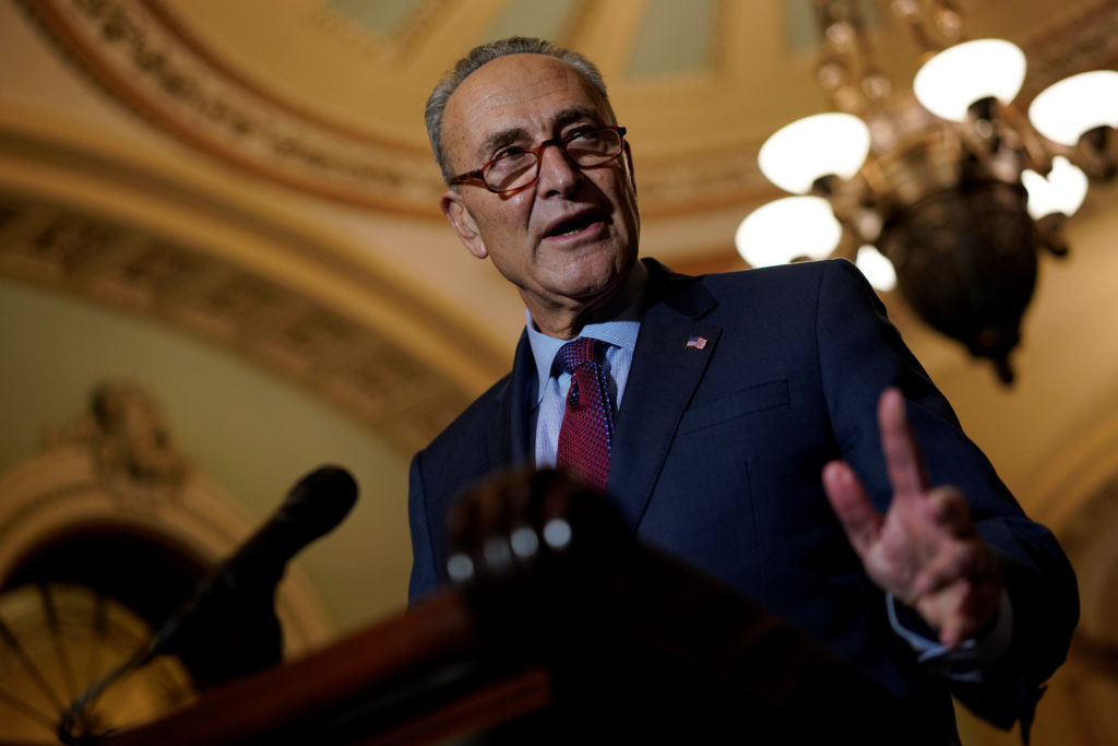 Senate Minority Leader Chuck Schumer speaks with reporters following the weekly policy luncheons on Capitol Hill in Washington, D.C. Photo by Aaron P. Bernstein/Reuters