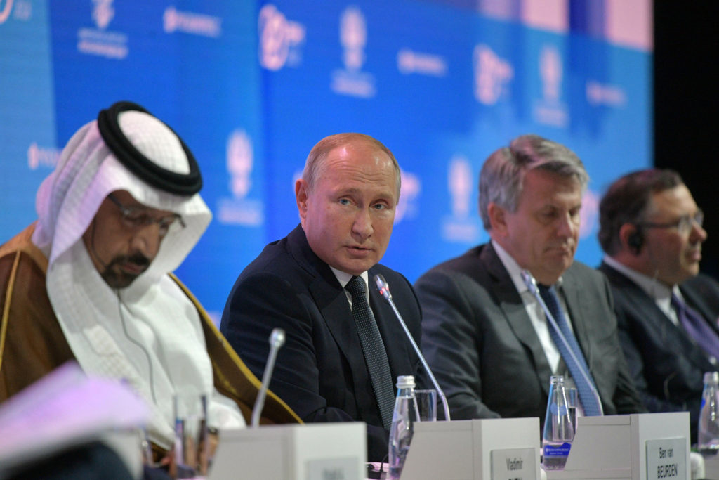 Russian President Vladimir Putin (second from left) attends a session of the Russian Energy Week forum in Moscow on Oct. 3. Photo by Sputnik/Alexei Druzhinin/Kremlin via Reuters