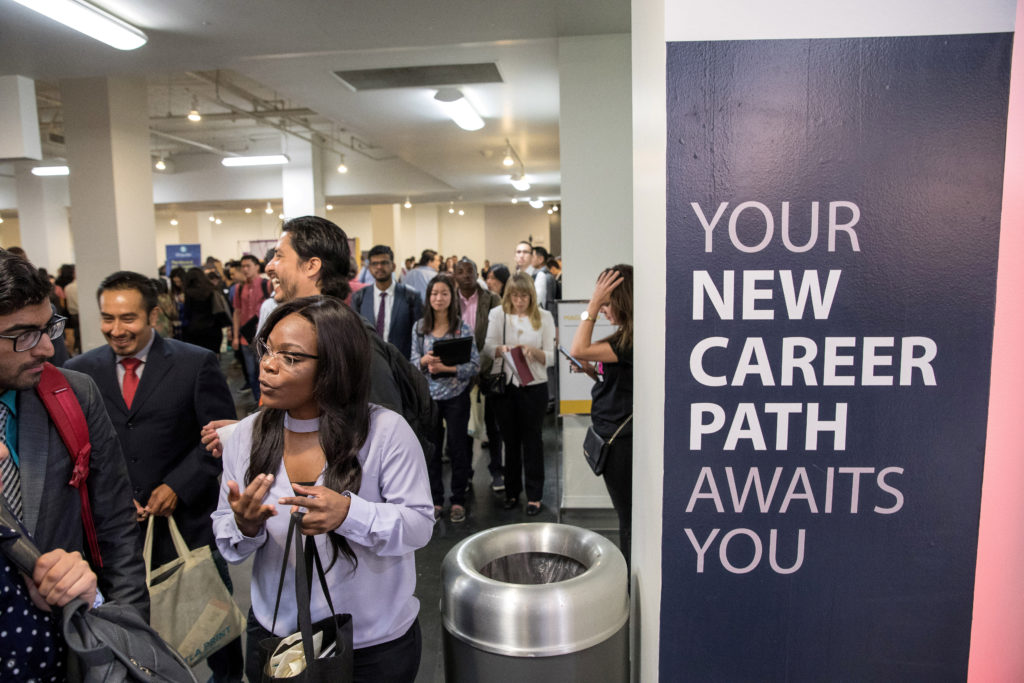 Job seekers and recruiters gather at TechFair in Los Angeles, California. The unemployment rate has dropped to an historic low, but the labor force participation rate remains below historic averages. Photo by Monica Almeida/Reuters