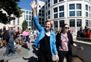 U.S. Senator Elizabeth Warren waves as activists gather for a protest march and rally in opposition to U.S. Supreme Court nominee Brett Kavanaugh outside U.S. District Court in Washington. Warren on Monday released DNA evidence supporting her claim that she has Native American ancestry. Photo by Kevin Lamarque/Reuters.