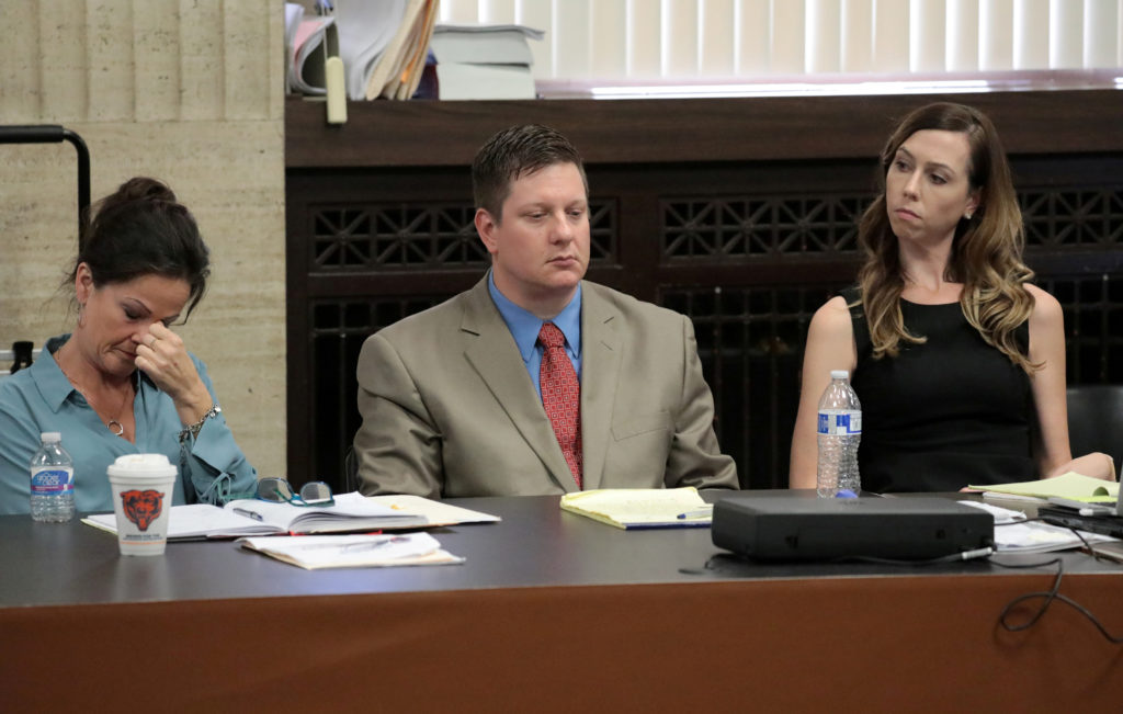 Police Officer Jason Van Dyke flanked by his attorneys Tammy Wendt and Elizabeth Fleming listen to closing statements at his trial for the shooting death of Laquan McDonald. Photo by Antonio Perez/Chicago Tribune/Pool via REUTERS