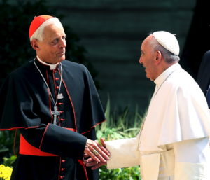 Pope Francis greets the Archbishop of Washington, Cardinal Donald Wuerl, upon returning to the Vatican Embassy in Washington on day three of his first visit to the United States September 24, 2015. The Pope has accepted Wuerl's resignation amid a sex abuse scandal in the Catholic Church. Photo by Gary Cameron/Reuters