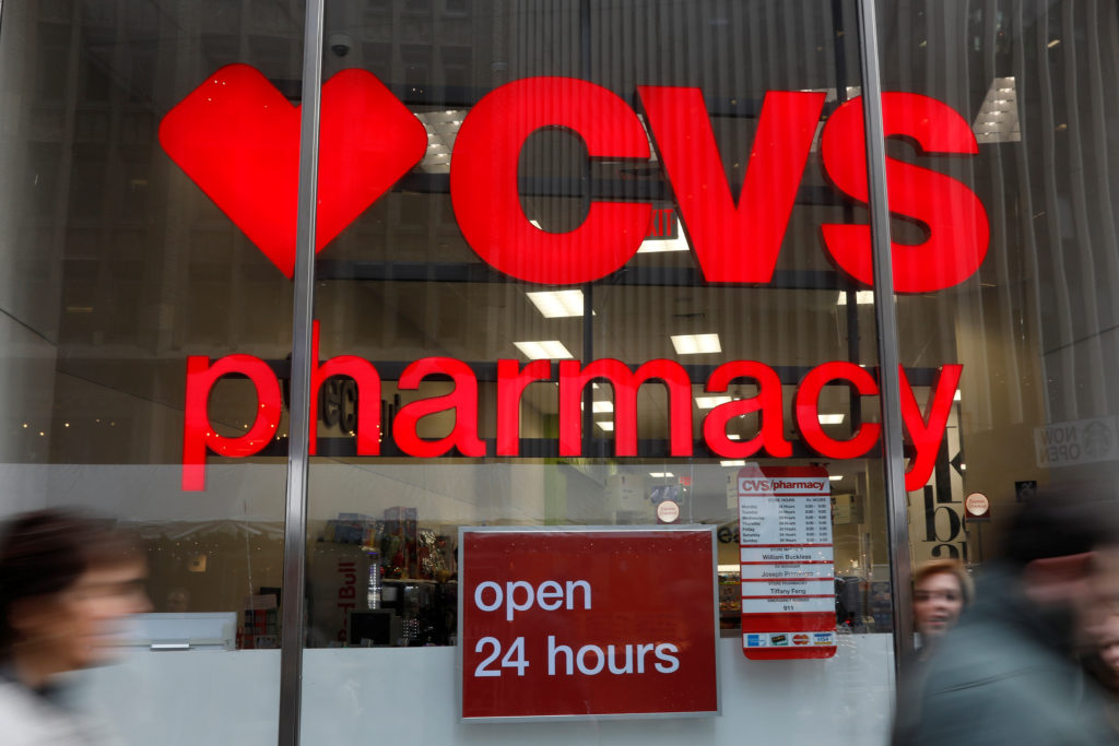 People walk by a CVS Pharmacy store in the Manhattan borough of New York City, New York, U.S., November 30, 2017. REUTERS/Shannon Stapleton