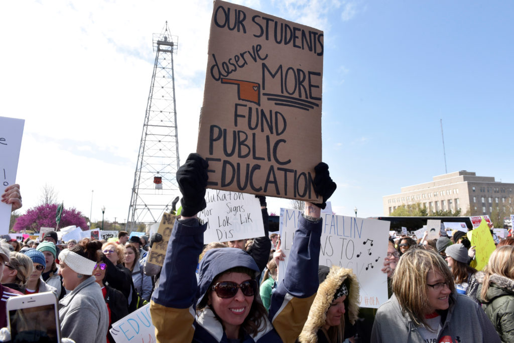 Teachers rally outside the state Capitol in April during a teacher walkout to demand higher pay and more funding for education in Oklahoma City. A surge in teacher activism is shaking up the midterm elections. Photo by Nick Oxford/Reuters
