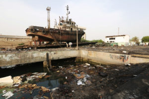 File photo of boat damaged by an airstrike at the Hodeida port in Yemen on May 27. Photo by Abduljabbar Zeyad/Reuters