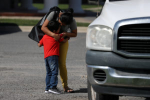 Anita Areli Ramirez Mejia, an asylum seeker from Honduras separated from her six year-old son Jenri near the Mexico-U.S. border, is reunited with him in Harlingen, Texas, in July. Photo by Loren Elliott/Reuters