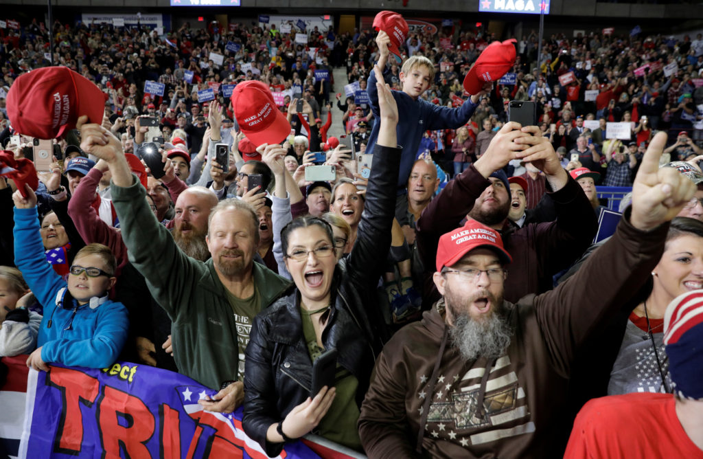 Supporters cheer as U.S. President Donald Trump arrives at a campaign rally in Topeka, Kansas