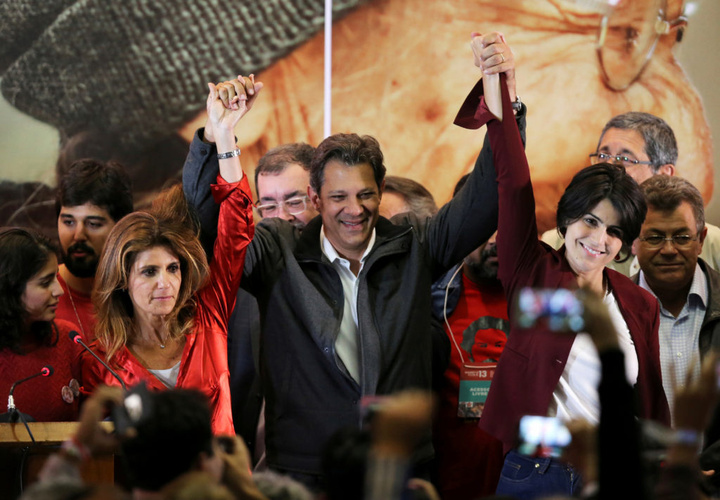 Fernando Haddad (R), presidential candidate of Brazil's leftist Worker Party (PT), reacts with supporters, in Sao Paulo, Brazil October 7, 2018. Photo by Paulo Whitaker/Reuters