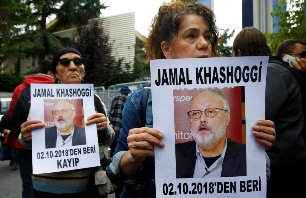 Human rights activists hold pictures of Saudi journalist Jamal Khashoggi during a protest outside the Saudi Consulate in Istanbul, Turkey. Photo by Osman Orsal/Reuters