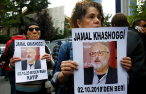 Human rights activists hold pictures of Saudi journalist Jamal Khashoggi during a protest outside the Saudi Consulate in Istanbul, Turkey October 9, 2018. Photo by Osman Orsal/Reuters