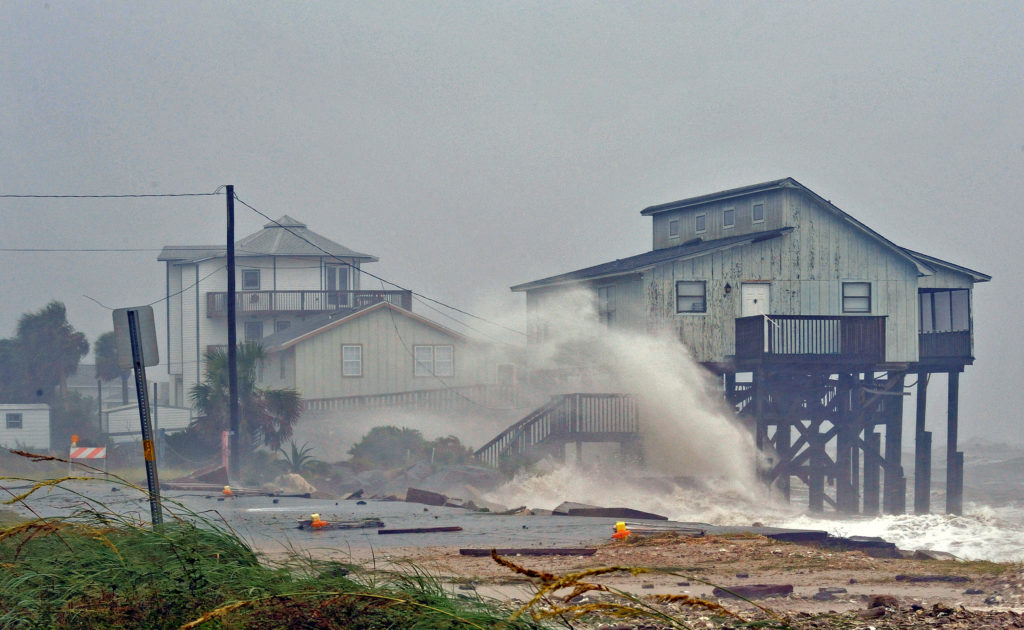 Waves crash on stilt houses along the shore due to Hurricane Michael at Alligator Point in Franklin County, Florida. Photo by Steve Nesius/Reuters