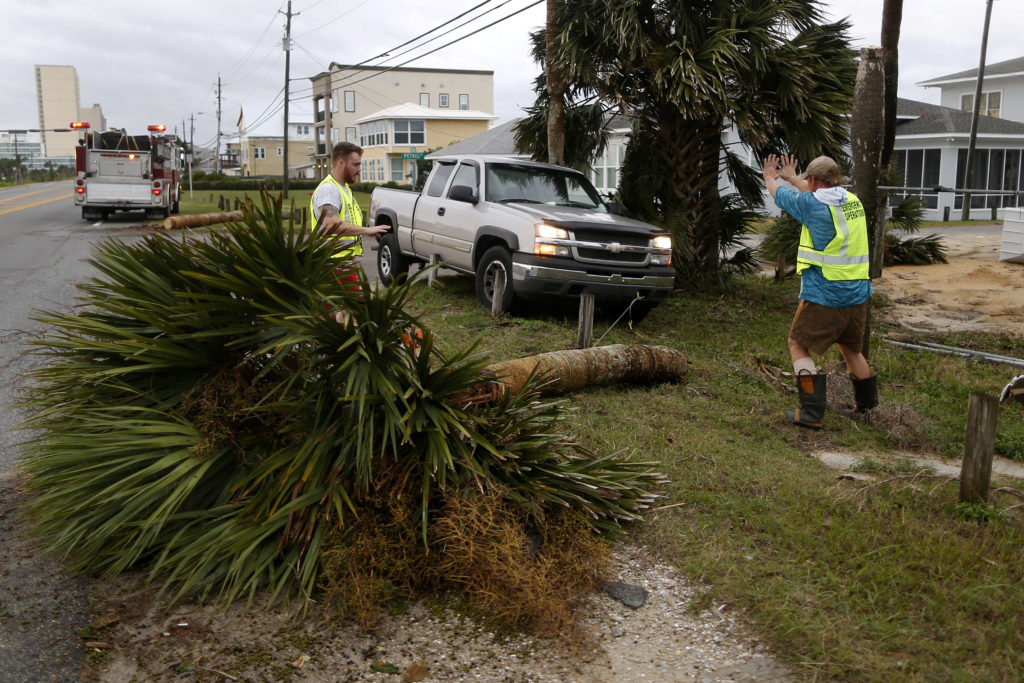 Emergency crews work to clear a street of debris during Hurricane Michael in Panama City Beach, Florida. Photo by Jonathan Bachman/Reuters