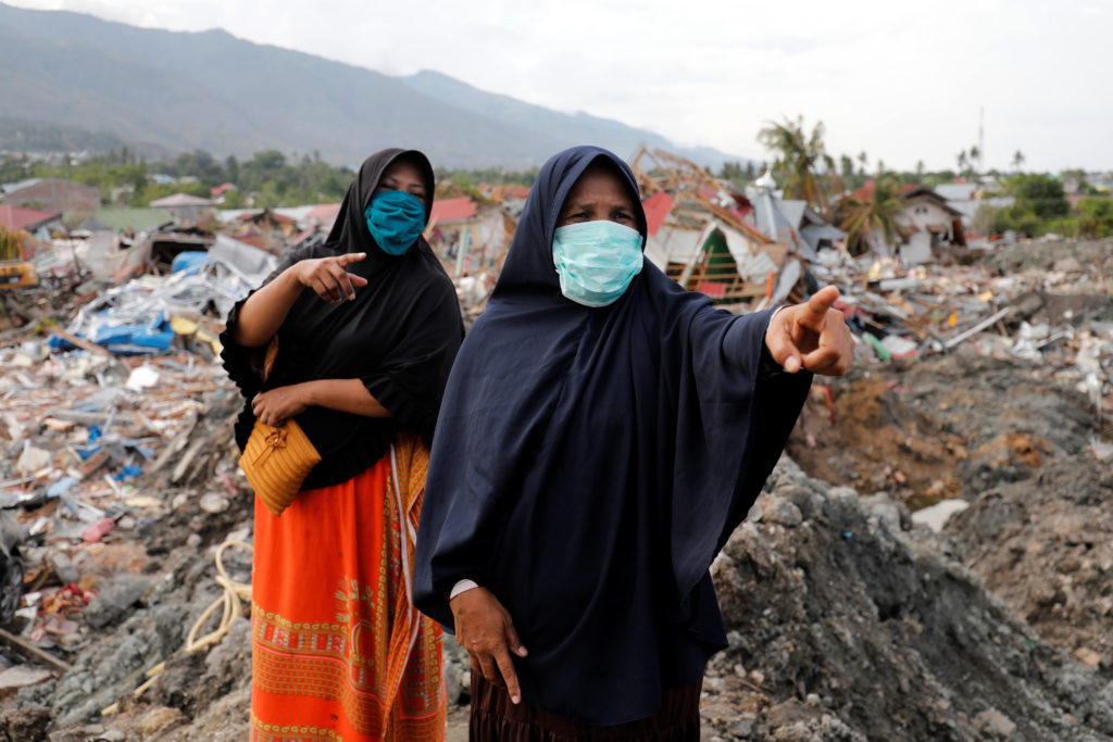 Women survey earthquake damage in the Balaroa neighborhood in Palu, Central Sulawesi, Indonesia, on Oct. 11. Photo by Darren Whiteside/Reuters