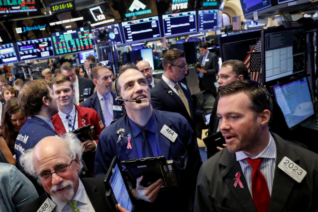 Traders work on the floor of the New York Stock Exchange. Stocks on Friday made back some of their losses from earlier in the week. Photo by Brendan McDermid/Reuters