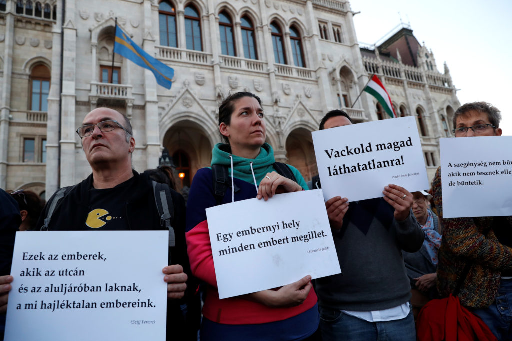 Civilians attend a demonstration in support of the homeless in front of the Hungarian Parliament in Budapest, Hungary. Photo by Bernadett Szabo/Reuters