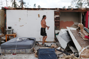 Gabriel Schaw, 40, walks through the remains of his home destroyed by Hurricane Michael in Fountain, Florida. Photo by Terray Sylvester/Reuters