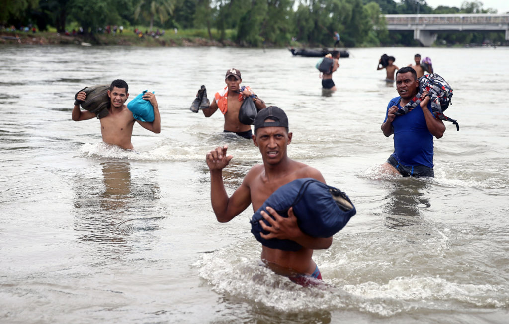 Some of the migrants crossed the Suchiate River to avoid the border checkpoint in Ciudad Hidalgo, Mexico, on Oct. 20. Photo by Edgard Garrido/Reuters