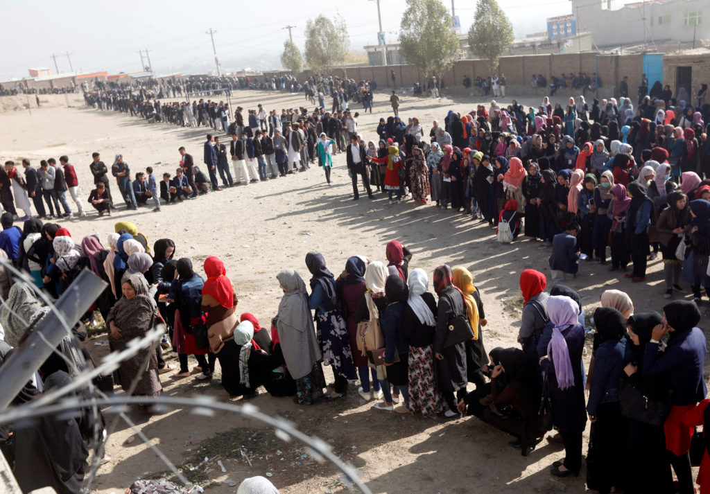 Afghans line up in Kabul to vote for 249 seats in the lower house of parliament on Oct. 21. Photo by Omar Sobhani/Reuters