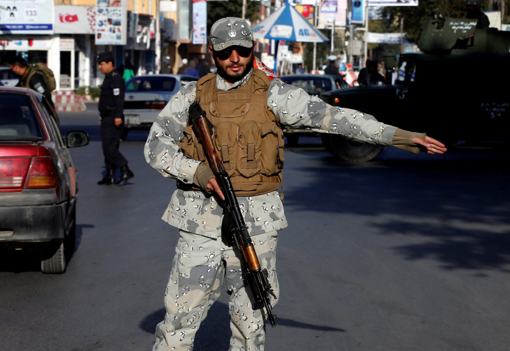 Afghan police stand guard at a checkpoint in Kabul during elections. Photo by Omar Sobhani/Reuters