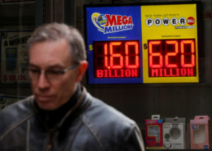 Signs display the jackpots for Tuesday's Mega Millions and Wednesday's Powerball lottery drawings in New York City. Photo by Brendan McDermid/Reuters