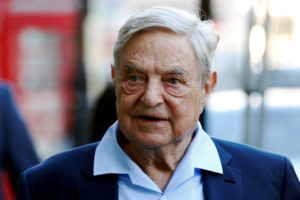Business magnate George Soros arrives to speak at the Open Russia Club in London, Britain. Photo by Luke MacGregor/Reuters