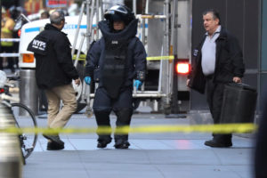 A member of the New York Police Department bomb squad is pictured outside the Time Warner Center in the Manahattan borough of New York City after a suspicious package was found inside the CNN Headquarters in New York. Photo by Kevin Coombs/Reuters