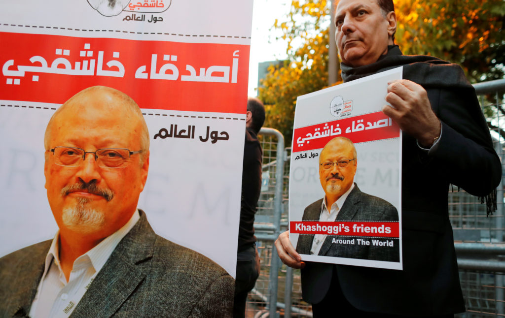 Friends of Saudi journalist Jamal Khashoggi hold posters and banners with his pictures during a demonstration outside the Saudi Arabia consulate in Istanbul, Turkey on Oct. 25, 2018. Photo by Osman Orsal/Reuters