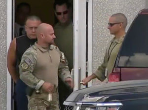 Cesar Altieri Sayoc, who was arrested during an investigation into a series of parcel bombs, is escorted from an FBI facility in Miramar, Florida October 26, 2018 in a still image from video. WPLG/Local10.com/Handout via Reuters