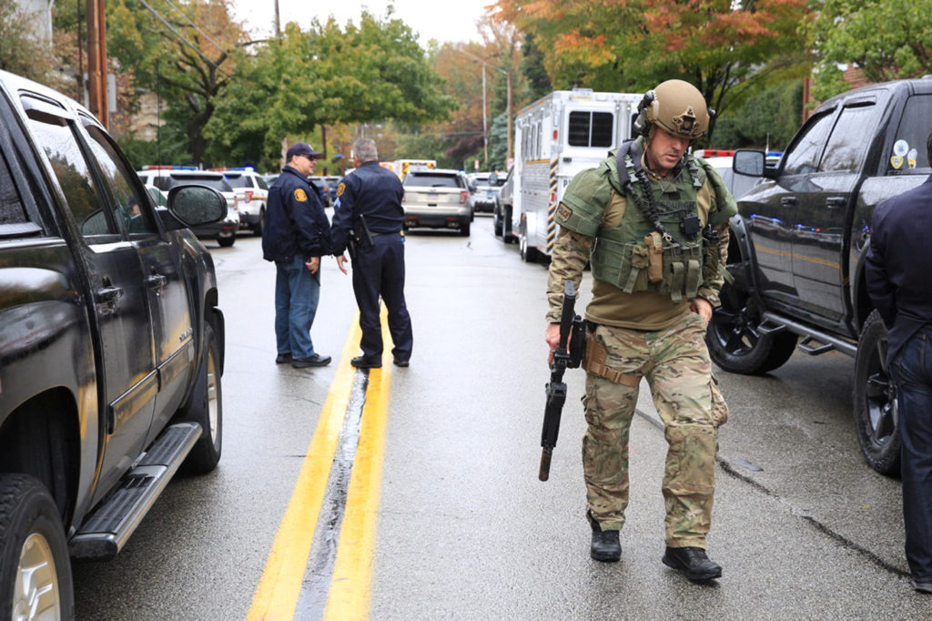 A SWAT police officer and other first responders respond after a gunman opened fire at the Tree of Life synagogue in Pitts...