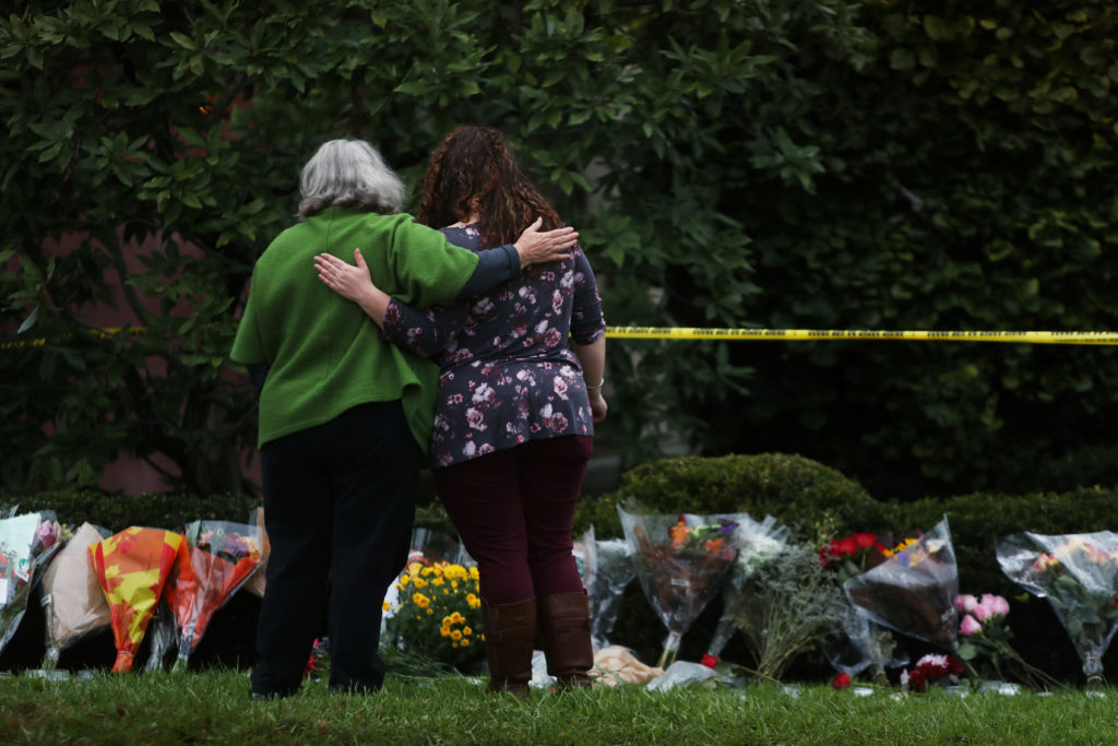 People visit an impromptu memorial at the Tree of Life synagogue following Saturday's shooting at the synagogue in Pittsburgh, Pennsylvania, U.S., October 28, 2018.   Photo by Cathal McNaughton/Reuters