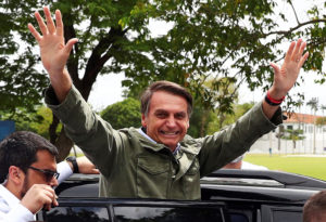 Jair Bolsonaro, far-right lawmaker and presidential candidate of the Social Liberal Party (PSL), gestures during a runoff election, in Rio de Janeiro, Brazil. Photo by Pilar Olivares/Reuters