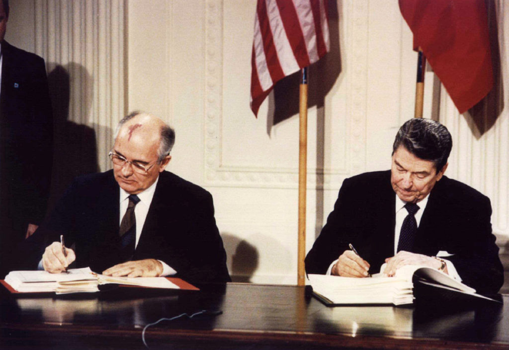 File photo of Soviet President Mikhail Gorbachev (left) and U.S. President Ronald Reagan signing the Intermediate-Range Nuclear Forces (INF) treaty at the White House on Dec. 8, 1987. Photo by Reuters stringer