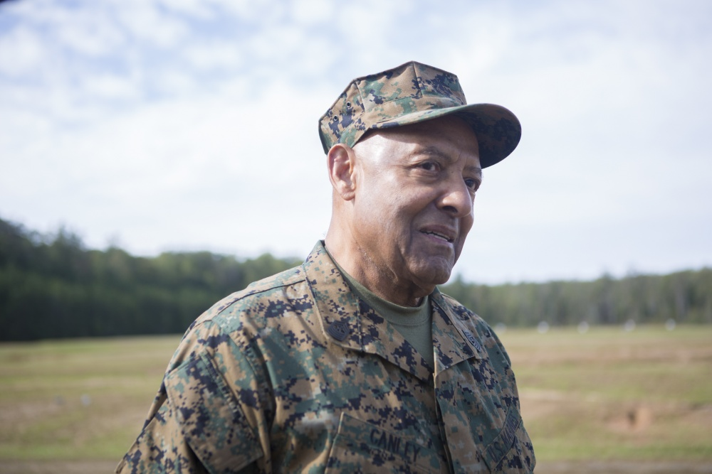 Retired Marine Corps Sgt. Maj. John Canley, soon to be the 300th Marine Medal of Honor recipient, listens to instructions before firing at Weapons Training Battalion in Quantico Va. Photo by Cpl. Daisha R. Johnson/U.S. Marine Corps