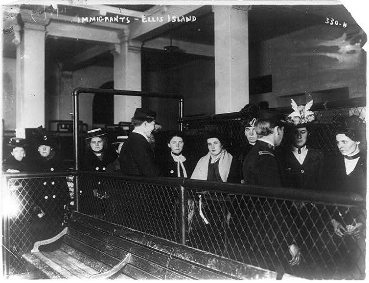Immigrants on Ellis Island. Photo via Library of Congress Prints and Photographs Division