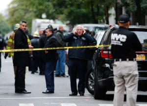 First respondents are seen on the scene where suspicious package was found in Midtown Manhattan on October 26, 2018 in New York City. - Democratic US Senator Cory Booker and former Director of National Intelligence James Clapper are the latest target in a spree of 12 suspicious packages sent to opponents of Donald Trump, the FBI said Friday. (Photo by KENA BETANCUR / AFP) (Photo credit should read KENA BETANCUR/AFP/Getty Images)