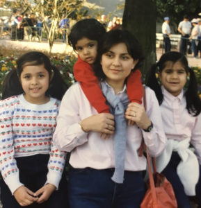 Seema Ahmed (center) is pictured here with her daughters (left to right) Sharmeen Qureshi, Naureen Ahmed and Mehreen Siddiqui. Photo courtesy of the Ahmed family