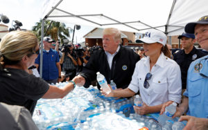 U.S. President Donald Trump and first lady Melania Trump give out water at a distribution center in Lynn Haven, Florida, as they tour areas ravaged by Hurricane Michael in Florida and Georgia, U.S., October 15, 2018. REUTERS/Kevin Lamarque
