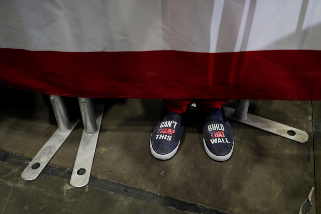 A rallygoer's shoes are seen during a campaign rally with U.S. President Donald Trump in Estero, Florida, U.S., October 31, 2018. REUTERS/Carlos Barria
