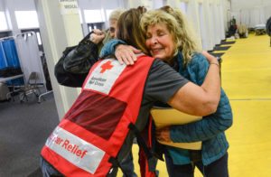 Joy and tears as Diane Papedo finds her brother, Phil Mazores and are reunited at the at the Butte County Fairground Red Cross shelter. Photo by Daniel Cima/American Red Cross