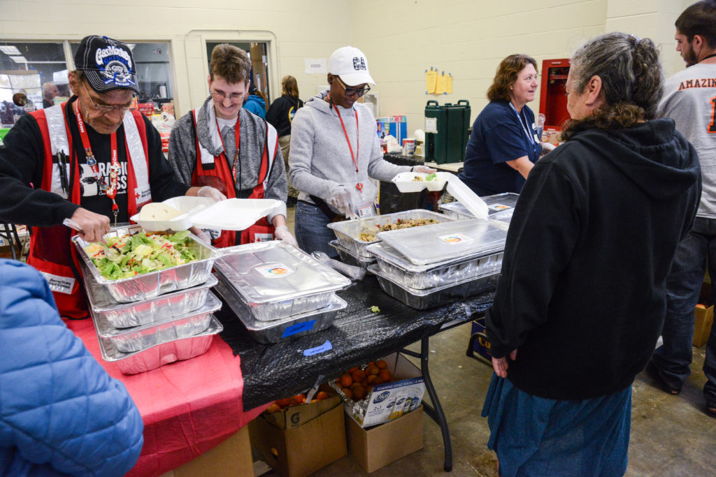 A lunch line at the Butte County Fairground shelter in Gridley, California. Shelter residents were provided meal prepared by Red Cross disaster partner, World Central Kitchen. Photo by Daniel Cima/American Red Cross