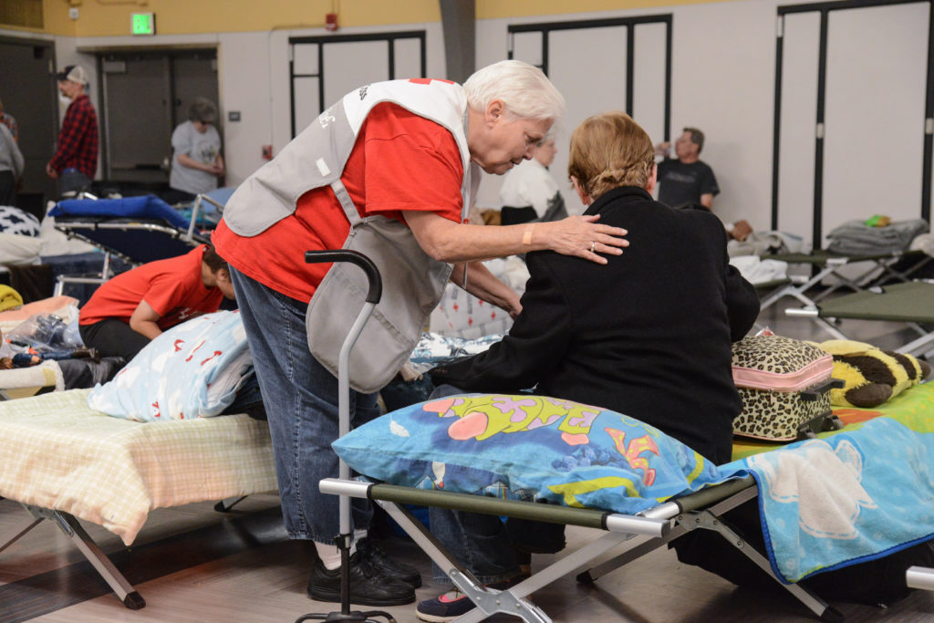 "Nurses Tamay Franklin and Susan Lee, check on Yvonne Trannan after she reported feeling short of breath with some mild chest discomfort. ""You all are so kind,"" Yvonne said. Photo by Daniel Cima/American Red Cross"
