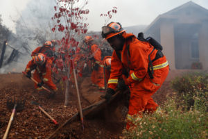 An inmate firefighter crew work to create a defensible space while battling the Camp Fire in Paradise, California, U.S. November 8, 2018. Photo by REUTERS/Stephen Lam