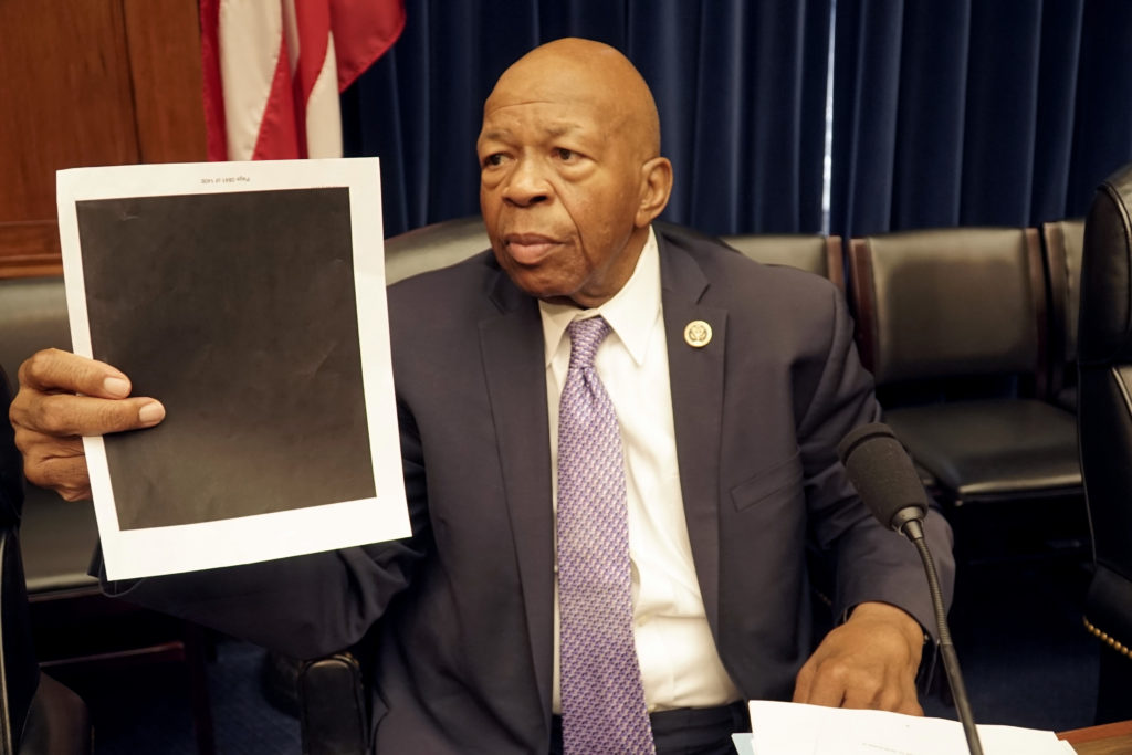 "Democratic Rep. Elijah Cummings of Maryland said there were ""inappropriate redactions"" among the nearly 1,500 pages were provided by the Forest Service to the committee. Cummings held up a heavily redacted page during the hearing. Photo by William Brangham/PBS NewsHour"
