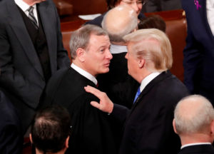 FILE PHOTO: U.S. President Donald Trump (R) talks with U.S. Supreme Court Chief Justice John Roberts as he departs after delivering his State of the Union address to a joint session of the U.S. Congress on Capitol Hill in Washington, U.S. January 30, 2018. REUTERS/Jonathan Ernst/File Photo