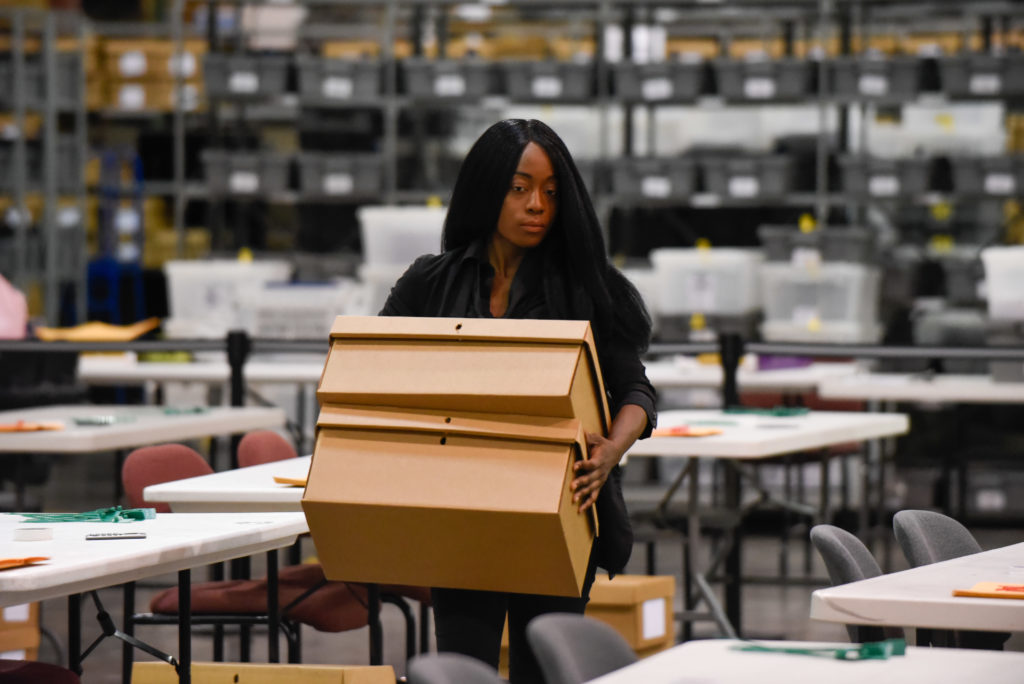 A woman sets up tables for hand counting ballots on Nov. 15, 2018, as Palm Beach County did not meet the midterm recount d...