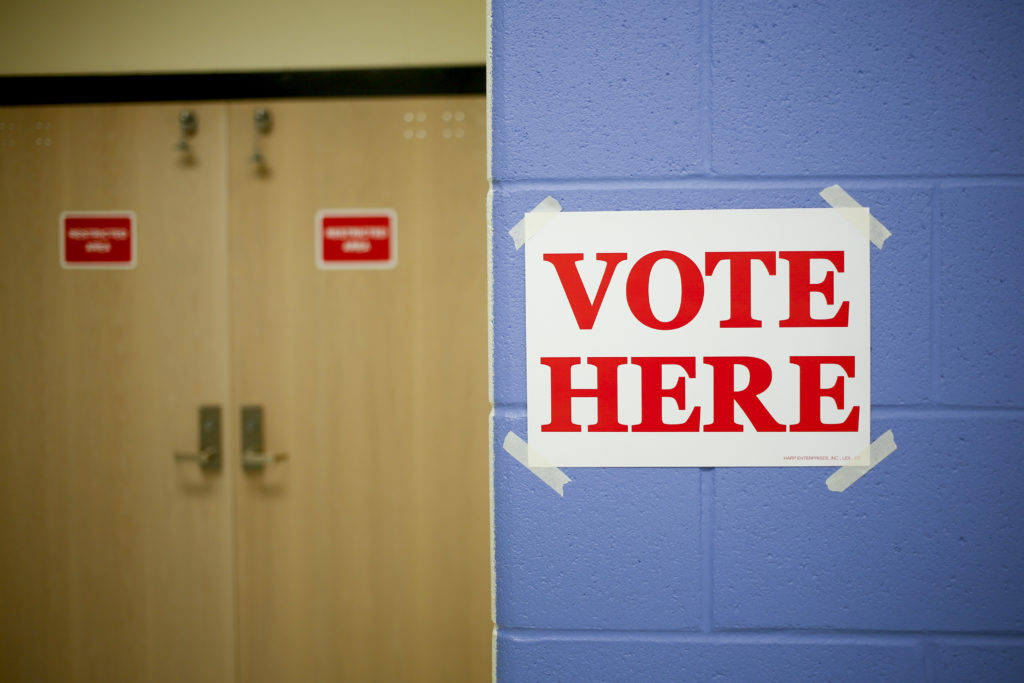 """A """"Vote Here"""" sign is displayed at a polling station in the Kentuck…"""