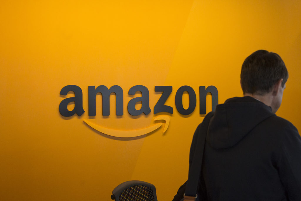 A visitor checks in at the Amazon corporate headquarters in Seattle, Washington. Amazon plans to build a second headquarters, which reportedly could be split between two locations. Photo by David Ryder/Getty Images