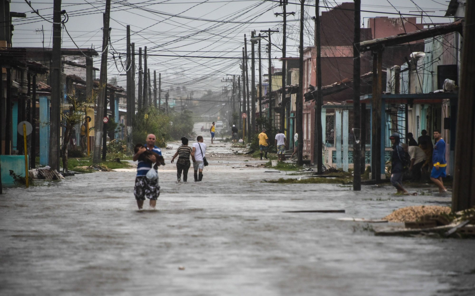 Cuban residents wade through a flooded street after Hurricane Irma passed over the island in 2017. Photo by Adalberto Roque/AFP/Getty Imagines